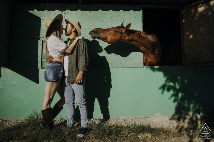 Portrait of an engaged couple and a curious horse in Adana Turkey
