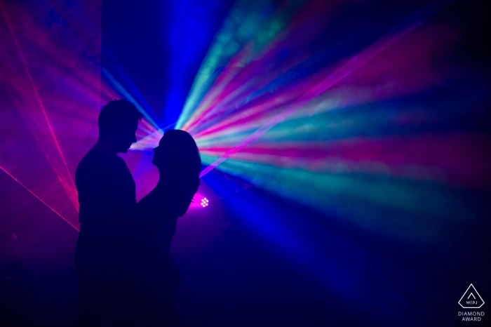 Veingrad, Bulgaria engagement photography with colorful lights streaming creating a party feel.