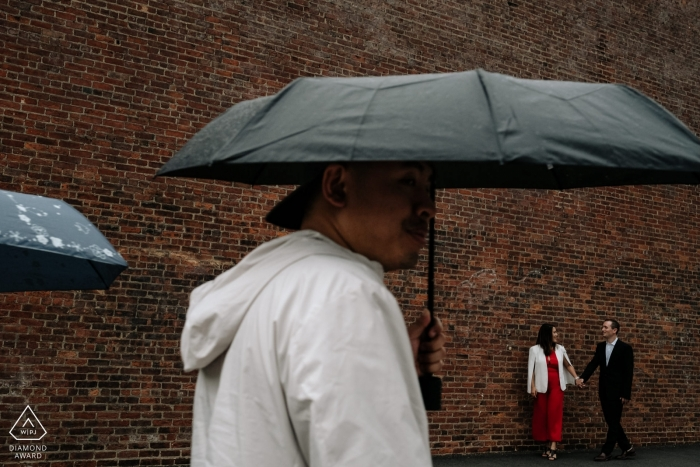 Brooklyn, New York engagement portraits on a rainy day with umbrellas