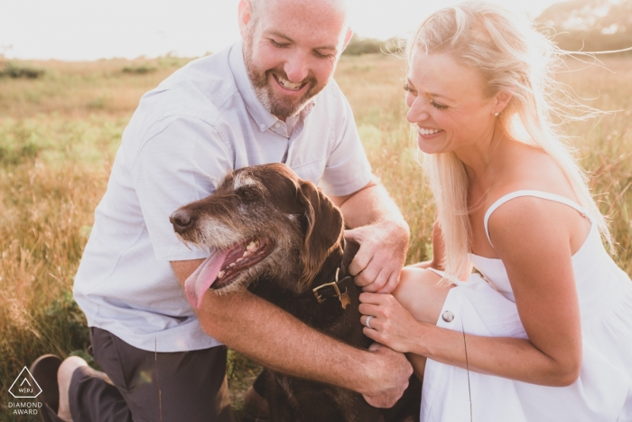 Sanford Farm Nantucket Engagement Portraits | Happy couple with their beloved 10 year old dog.