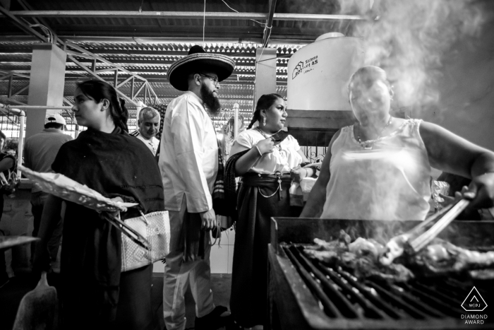 Engagement photo session with a couple checking out the grill at the Sunday Market, Tlacolula, Oaxaca, Mexico