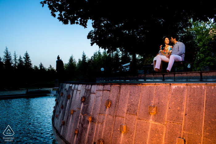 Ankara PreWedding Photography Session - Couple is sitting on a bench next to a big fountain