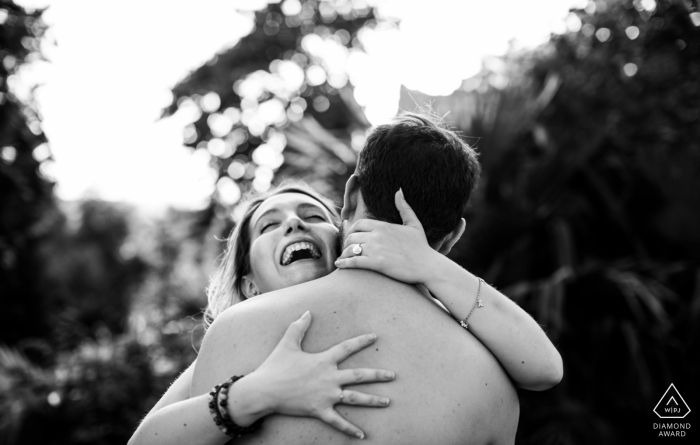 Casterat-Lectourois, Gers | A girl laughing in the arm of her boyfriend during pre-wedding engagement photoshoot