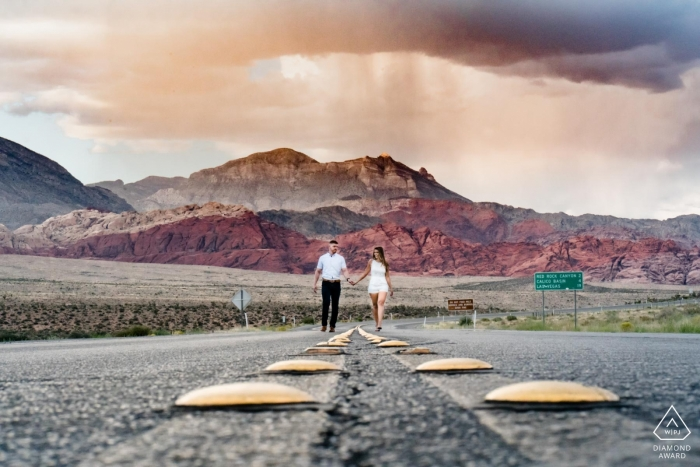 Engagement Photographer for Red Rock, Nevada | The road lines lead the eyes straight to the couple