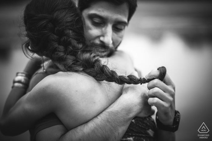 Engagement Photographer for Viareggio - Portrait contains: hug, black and white, braid, water