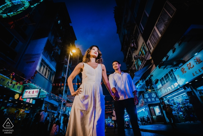 Engagement Portrait from Temple Street Night Market, Hong Kong  - Photography contains: city, couple, stores, markets