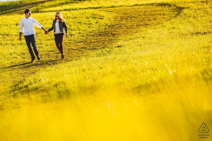 """Engagement Photographer for Stroud Preserve, West Chester PA - Photographer said """"Saw a sea of yellow and wanted them walk through it."""""""
