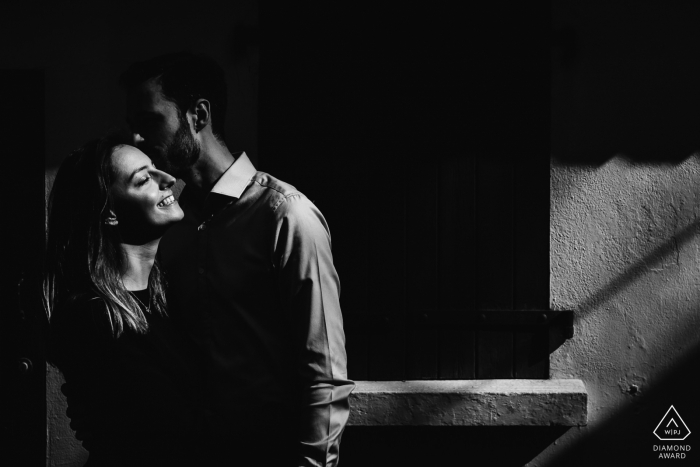Biarritz, France B/W Engagement Photos : Couple kissing in a street of Biarritz