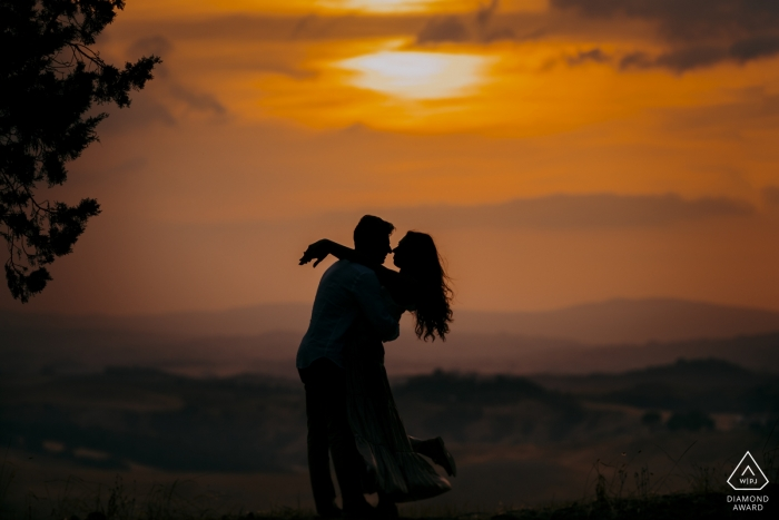 Tuscany, a romantic embrace at sunset in Siena during engagement portrait shoot