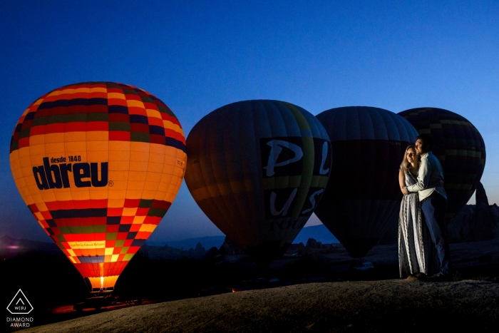 cappadocia, turkey engagement photo session with a photographer light and hot air balloons