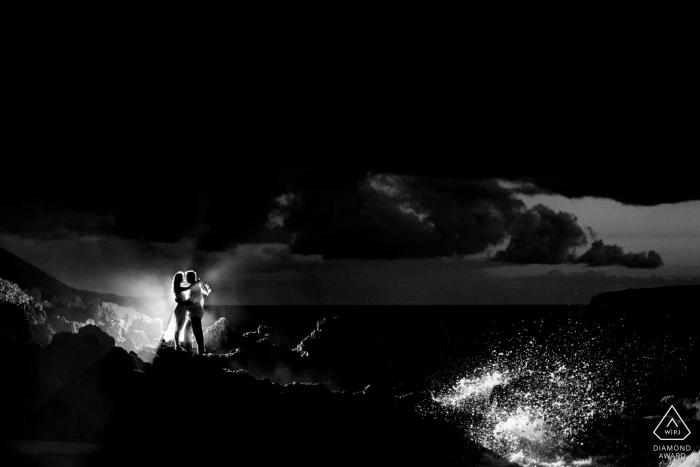Wailea, Maui, Hawaii   Black and white couple with splashing waves after dark