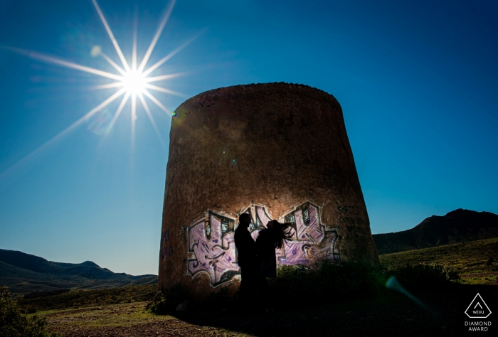 Sunset engagement portrait session with blue skies in Almería