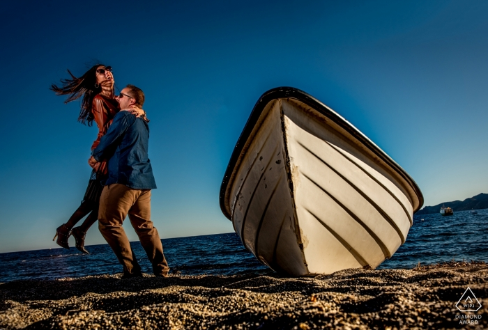 Almería - Spain Engagement Portraits with the Sun and beach by a boat