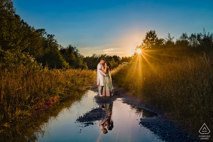 Cambridge, MD Sunset Photographs. Engaged Couple Portraits with Sunset and Water Reflections.