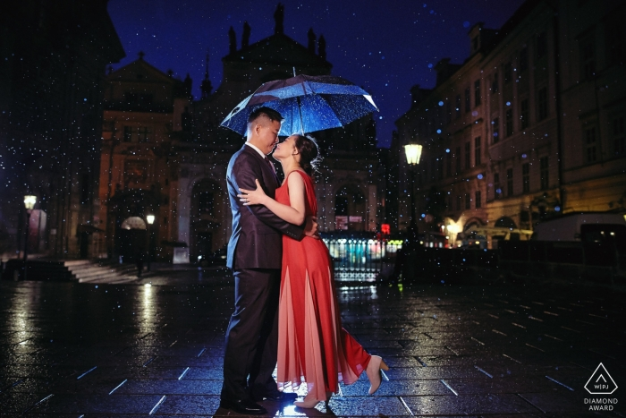 Prague, Czech Republic, Charles Bridge — USA couple during their night time portrait session in the rain