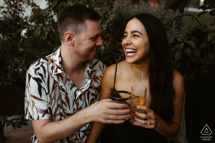 Los Angeles Engagement Portraits — Shiny, happy couple toasing their drinks!