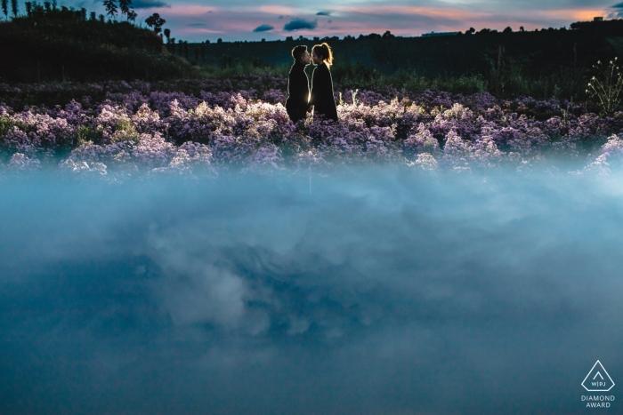 Da Lat, Vietnam Engagement Portrait Photographer: Evening kiss in the flower field