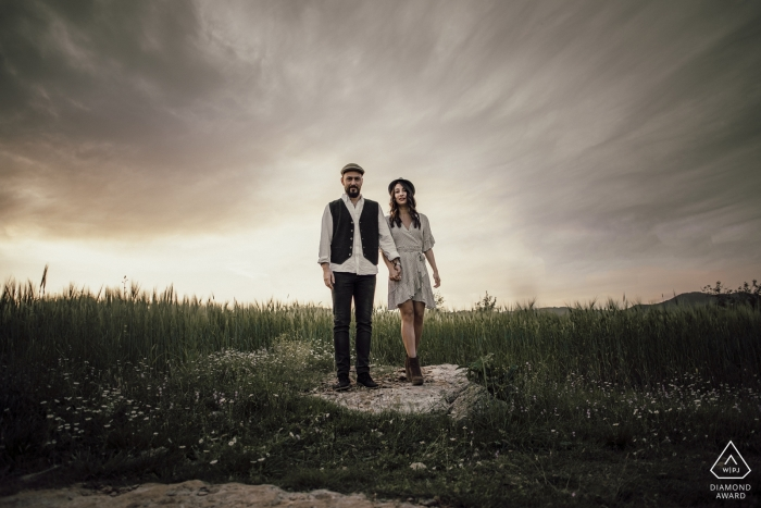 Couple standing on a rock with an interesting sky behind them in Mersin Turkey