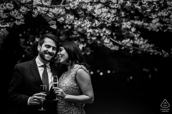 Engagement Photography at the Tidal Basin, Washington DC — A couple toasts to their romantic New Year's Eve Wedding plans