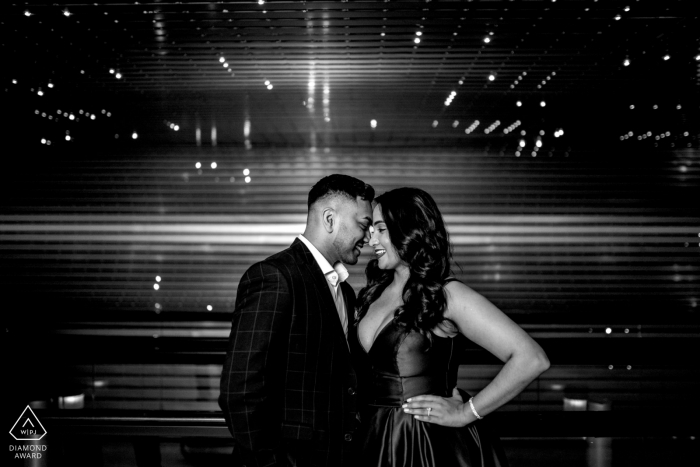 Engagement photographer — A couple laughs together in the Leo Villareal, Multiverse at the National Gallery of Art.
