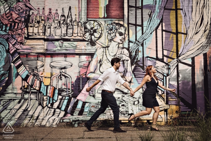Red Hook, Brooklyn, NY Engagement photography of couple running