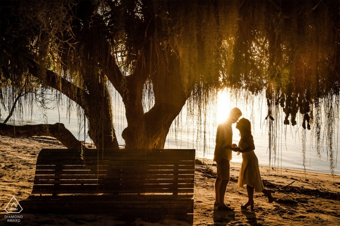 Linhares, Espírito Santo, Brazil pre wedding portrait at the water during sunset.