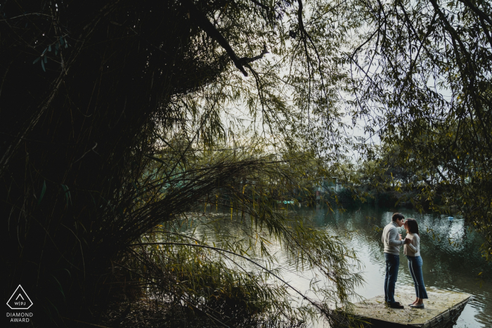 Napes wedding photography.  Image contains: trees, water, engaged couple, lake
