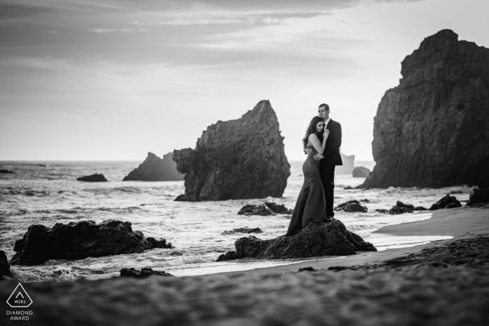 El Matador Beach Malibu CA Beach portrait of a couple standing on a rock at the water.