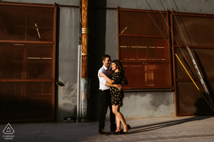 Downtown Los Angeles, CA Engagement Session - Couple embracing in alley in DTLA