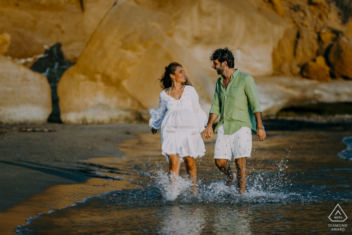 Agrigento, Sicily, Italy Beach Photo Session   They run together towards happiness in the water