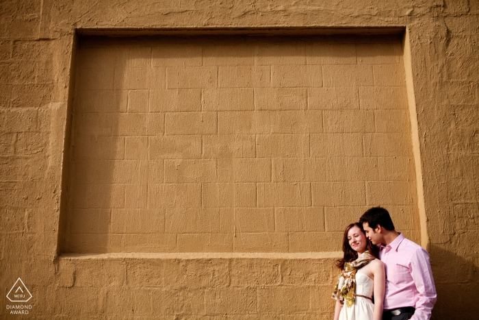 Brooklyn, NY Couple in front of wall during an afternoon engagement session.
