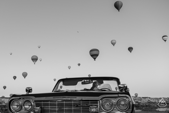 Cappadocia, Turkey Early morning engagement portraits with hot air balloons and vintage convertible car