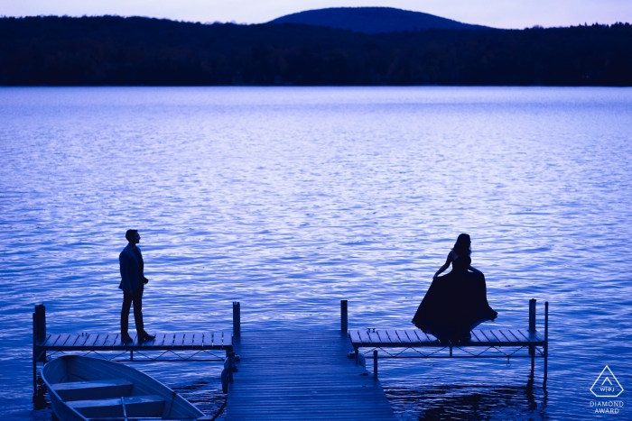 San Diego, CA Engagement Photography Session - Image contains:Couple Silhouetted by a lake.