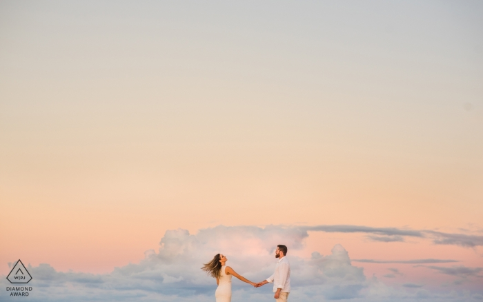 Alagoas, Brazil Engagement Photography - Image contains: pastel, sky, clouds, flying, floating