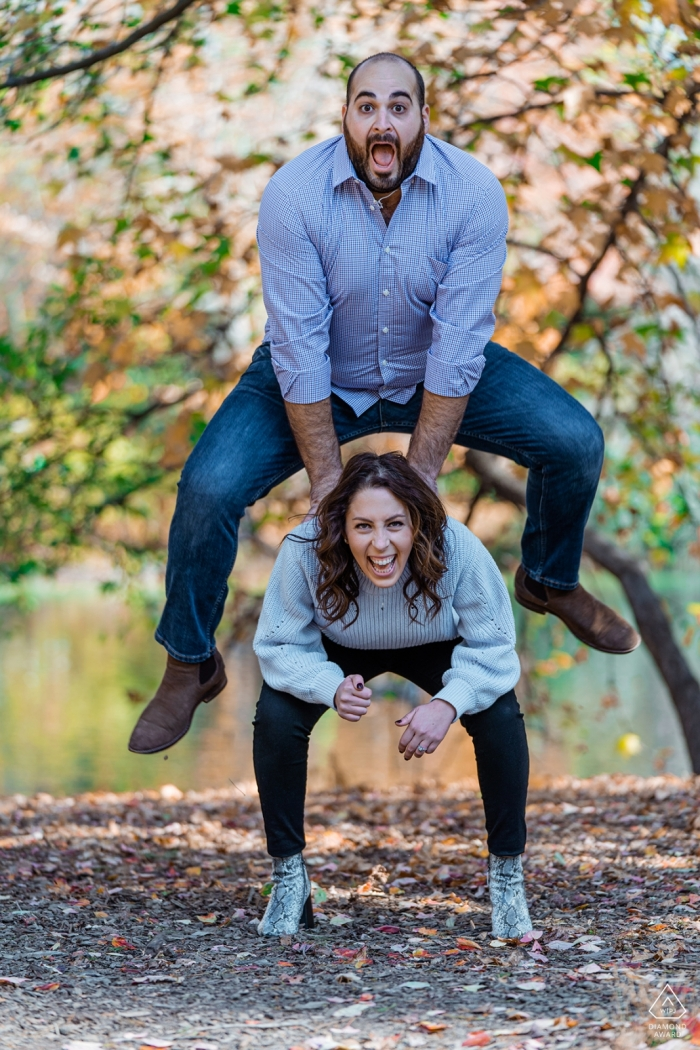 London, UK Engagement Photo Session - Image contains: fun, couple, leap, frog, happy, joy