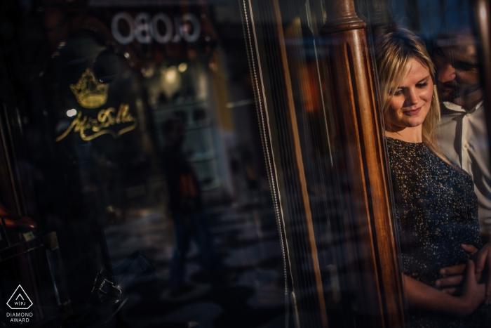 Cascais Engagement Couple Photography - Portrait contains:reflections, embrace, glass, windows