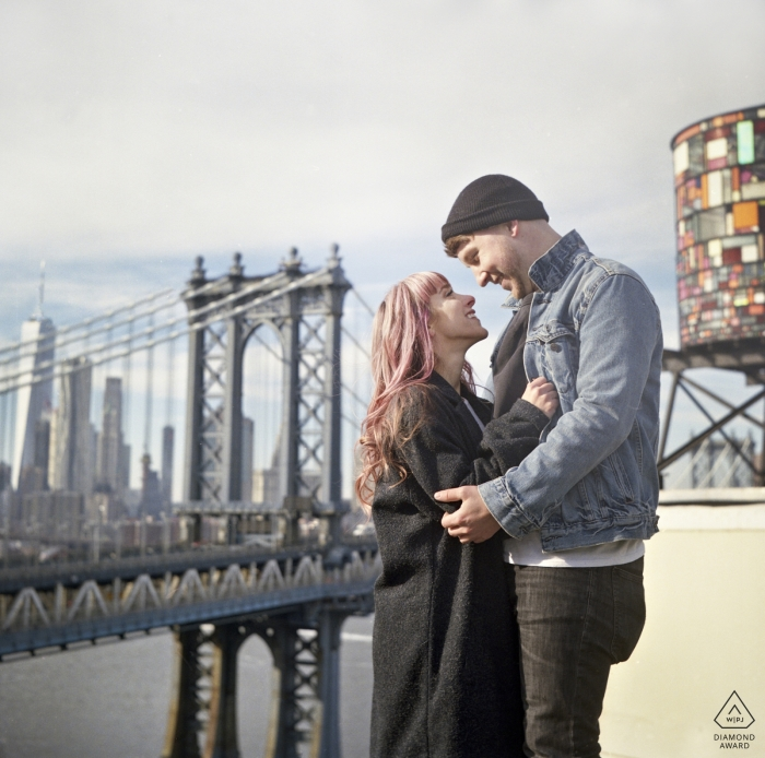 Dumbo rooftop, NYC Couple Braving the cold for the view | Engagement Couple Photography - Portrait contains: bridge, art, square, format, vintage, antique, Holga