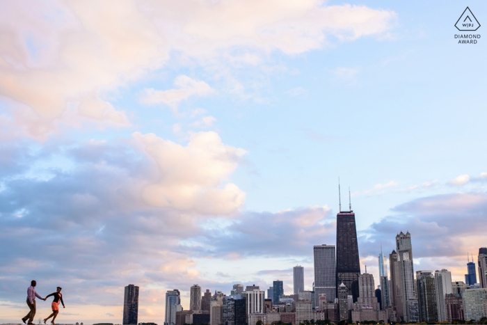 North Ave Beach Chicago Engaged Couple strolling along skyline during portrait session
