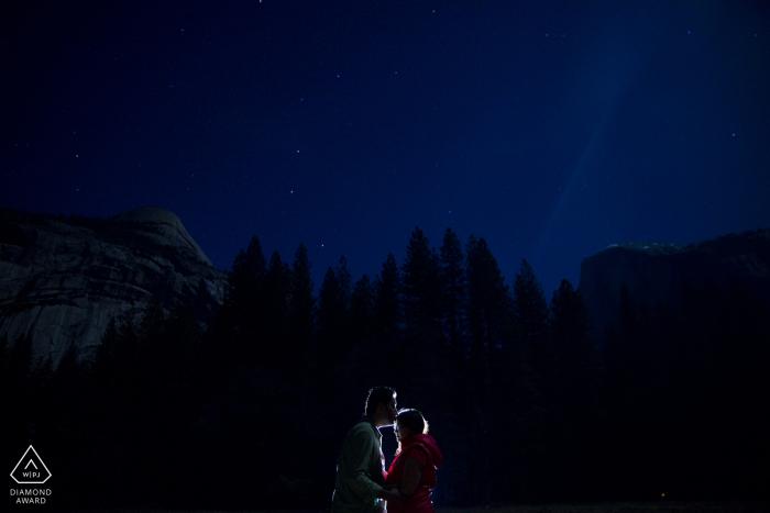 Yosemite Engagement Couple Photography - Portrait contains:lit, night, trees, sky, blue, stars
