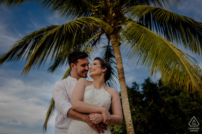 Aracruz, Espírito Santo, Brazil - Santa Cruz Beach Portrait session with a couple under the palm tree.