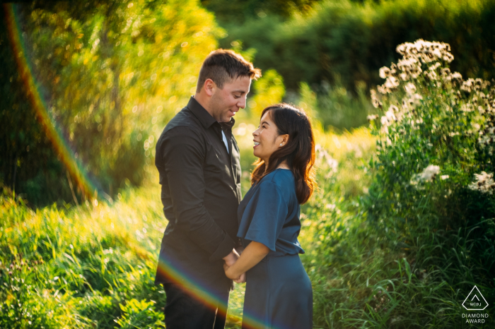 Edmonton , AB , Canada pre wedding portraits - A couple in love during the sunset light