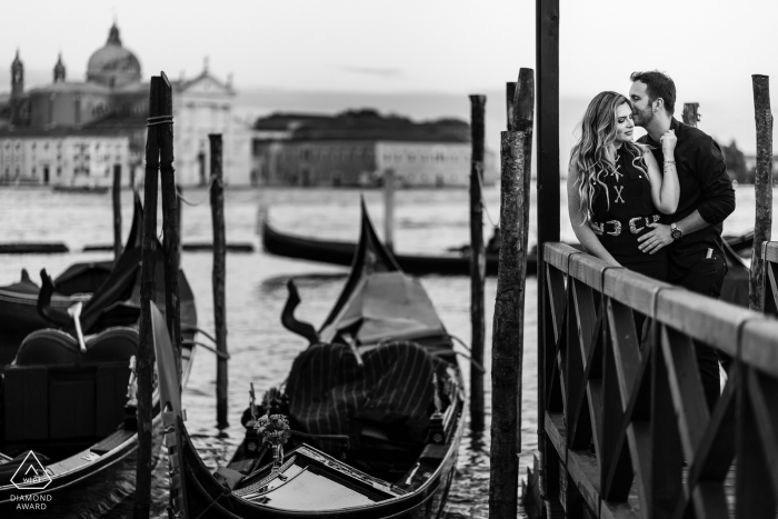 Venezia, Italy pre-wedding photo-shoot - Sweet picture at the pier of a young, engaged couple