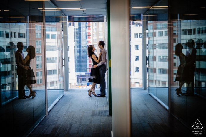 Johns Hopkins Baltimore Campus Couple Portrait - Reflections in glass during photo shoot for engagement pictures.