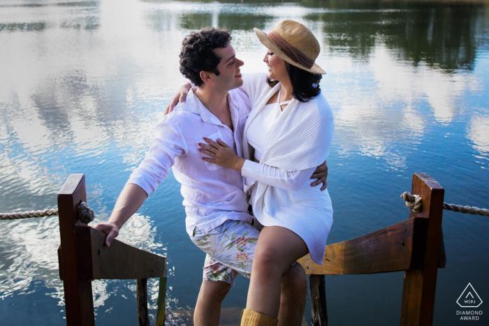Brazil Teresópolis Engagement Session Photography - Portrait contains:water, dock, boat, ramp, beach, lake, hug, couples