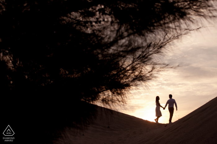Melaka, Malaysia sunset couple walking and holding hands during engagement portraits