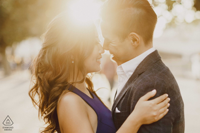 London Couple with sun setting behind them during engagement photoshoot session