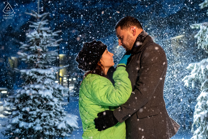 İncek, Ankara Prewedding Photoshoot - A Couple is hugging and looking at each other under the snow.