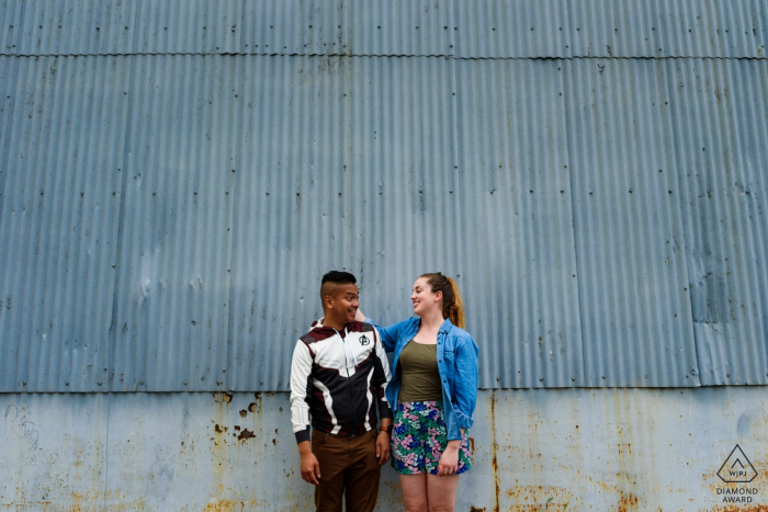 Old Montreal, Quebec Engagement photo against a grey metal wall in Montreal