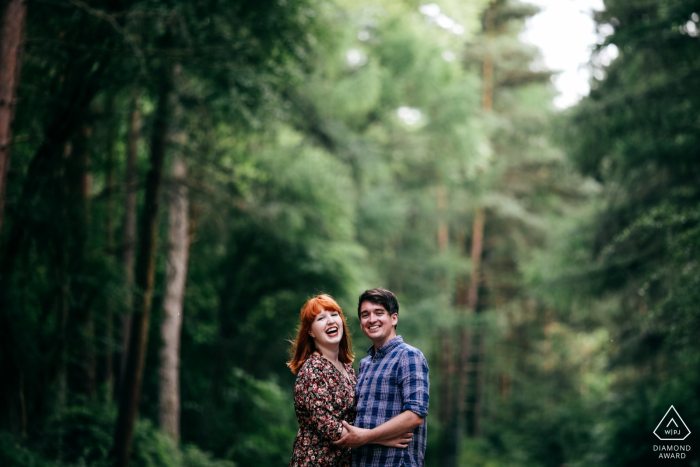 Irchester Country Park Pre-Wedding Shoot   Happy engaged couple laughing during engagement session