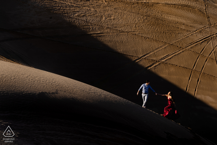 Glamis, California Desert Couple Session   Couple in the abstract landscape of the de